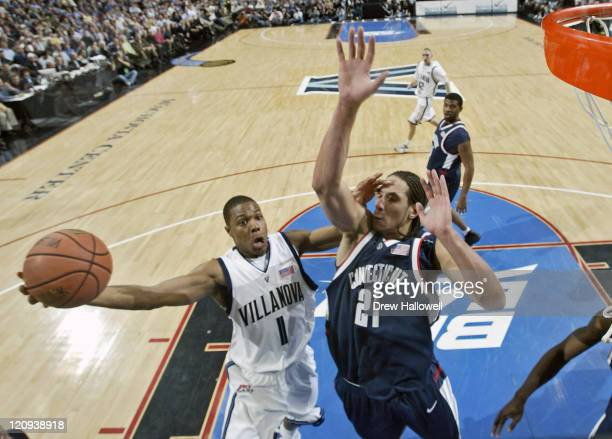 Villanova's Kyle Lowry goes up for a shot over Connecticut's Josh Boone Monday February 13 2006 at the Wachovia Center in Philadelphia PA Villanova...