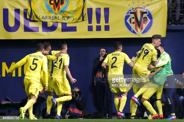 Villareal players celebrate their first goal during the Spanish League football match Villarreal CF vs Real Madrid at El Madrigal stadium in Vilareal...