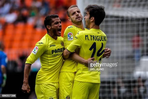 Villareal's forward Roberto Soldado celebrates a goal with teammates during the Spanish League football match Valencia CF vs Villarreal CF at the...