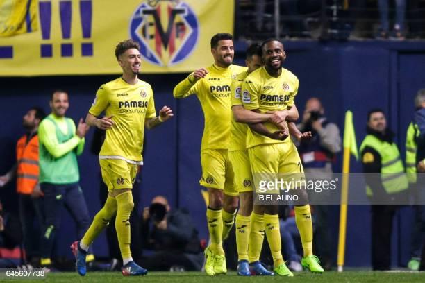 Villareal's French forward Cedric Bakambu celebrates with teammates after scoring a goal during the Spanish League football match Villarreal CF vs...