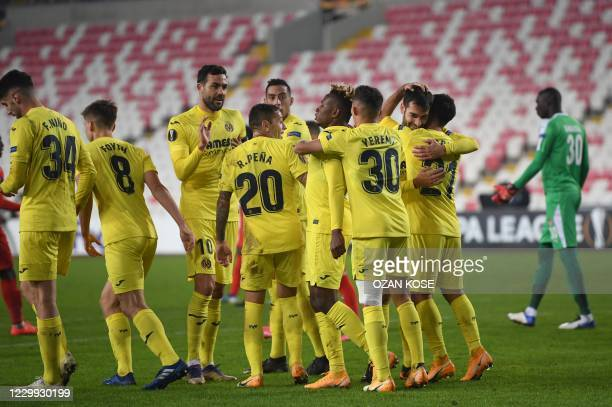 Villareal's Nigerian midfielder Samuel Chukwueze celebrates with his teammates after scoring a goal during the UEFA Europa League group I football...