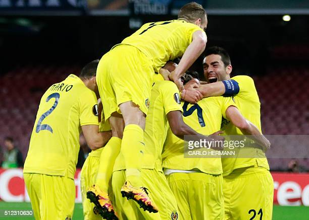 Villareal's players celebrate after the goal of teammate Spanish midfielder Tomas Pina during the UEFA Europa League Round of 32 second leg football...