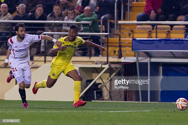 Villarreal Castellon Spain 21 Nicolas Martin Pareja of Sevilla CF competes with Uche during Europa League round of 16 match between Villarreal CF and...