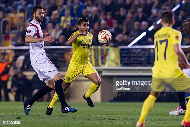 Villarreal Castellon Spain Jonathan dos santos competes with 21 Nicolas Martin Pareja of Sevilla CF during Europa League round of 16 match between...