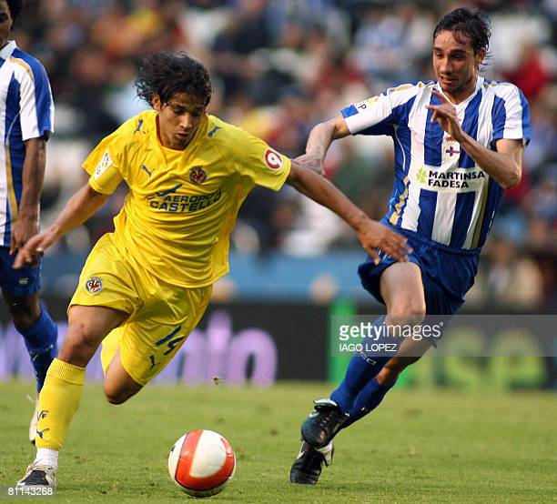 Villarreal CF?s Angel vies with Deportivo Coruna's Pablo Amo during their Spanish league football match at the Riazor Stadium on May 18, 2008 in...