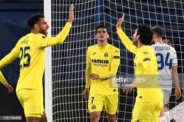 Villarreal players celebrate their second goal scored by Villarreal's Spanish forward Gerard Moreno during the UEFA Europa League round of 16 second...