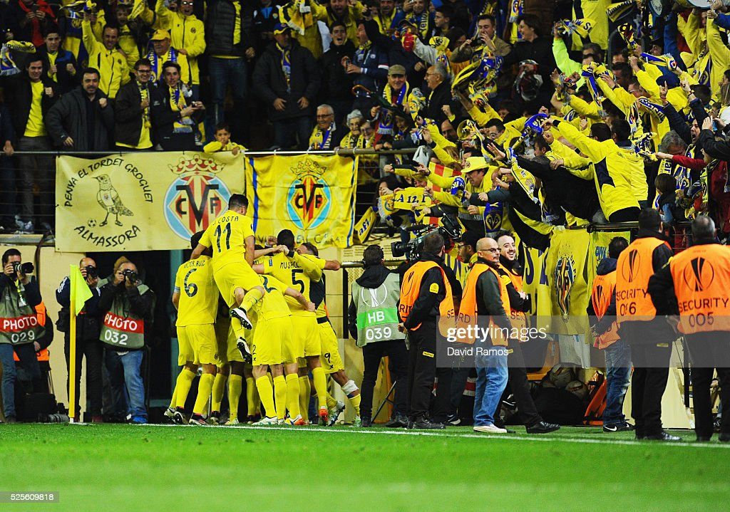 Villarreal players celebrate with fans as Adrian Lopez of Villarreal scores thie first goal during the UEFA Europa League semi final first leg match between Villarreal CF and Liverpool at Estadio El Madrigal on April 28, 2016 in Villarreal, Spain.