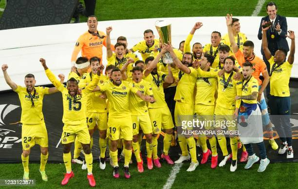 Villarreal players hold up their trophy as they celebrate winning the 2021 UEFA Europa League football final between Spain's Villarreal and England's...