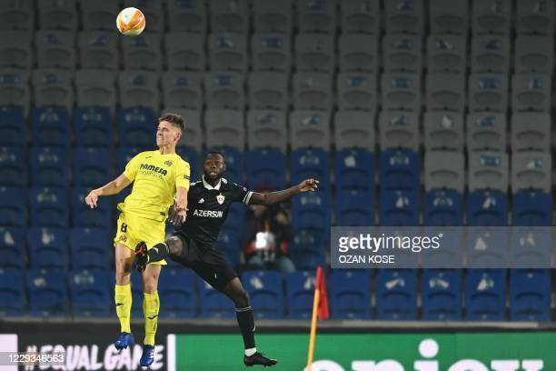 Villarreal's Argentine defender Juan Foyth jumps for the ball with Garabagh's Haitian forward Donald Guerrier during the UEFA Europa League group I...