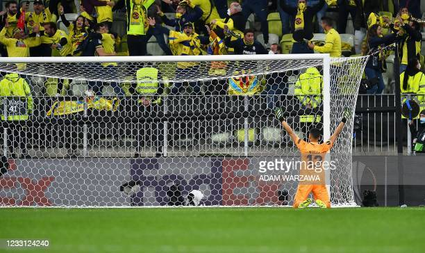 Villarreal's Argentine goalkeeper Geronimo Rulli celebrates after stopping a penalty in a shoot-out during the UEFA Europa League final football...