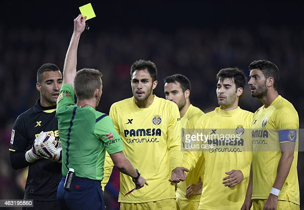 Villarreal's Argentinian defender Mateo Musacchio is handed a yellow card by the referee during the Spanish Copa del Rey semifinal first leg football...
