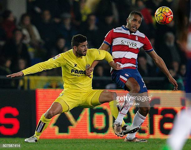 Villarreal's Argentinian defender Mateo Musacchio vies with Granada's French forward Youssef ElArabi during the Spanish league football match...