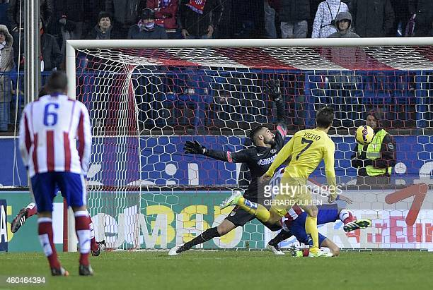 Villarreal's Argentinian forward Luciano Dario Vietto scores a goal during the Spanish league football match Club Atletico de Madrid vs Villarreal CF...