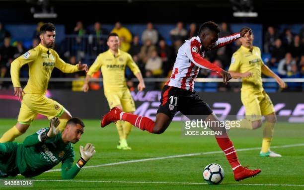 Villarreal's Argentinian goalkeeper Sergio Asenjo vies with Athletic Bilbao's Spanish forward Inaki Williams during the Spanish league football match...