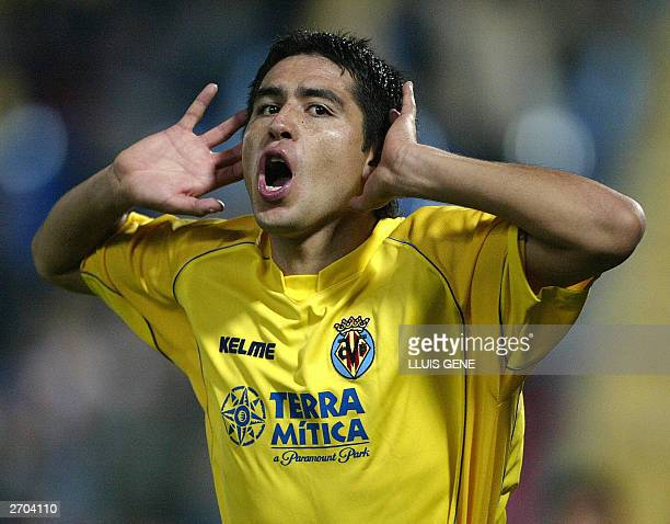 Villarreal's Argentinian Juan Riquelme celebrates scoring his first goal against Torpedo Moscow during their UEFA Cup second round first leg soccer...