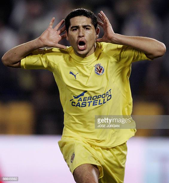 Villarreal's Argentinian Roman Riquelme celebrates his second goal against Osasuna's during their Spanish League match at Madrigal stadium of...