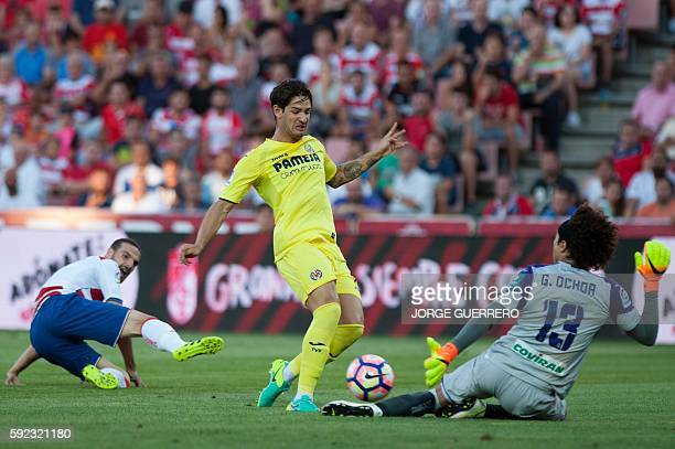 Villarreal's Brazilian forward Rodrigues da Silva Pato vies with Granada's Mexican goalkeeper Guillermo Ochoa during the Spanish league football...