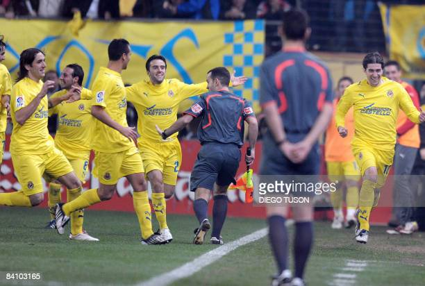 Villarreal's Cani celebrates after scoring a goal during their Spanish league football match against Barcelona at Madrigal Stadium in Villarreal on...