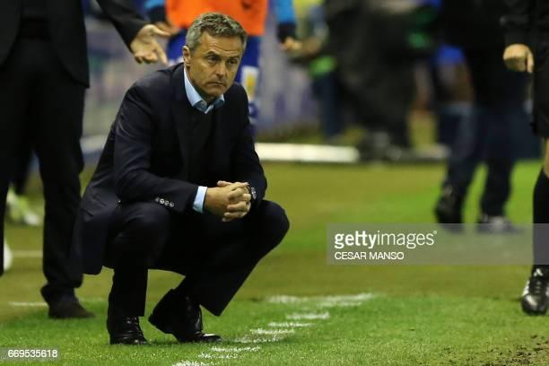 Villarreal's coach Fran Escriba Segura crouches during the Spanish league football match Deportivo Alaves vs Villarreal CF at the Mendizorroza...
