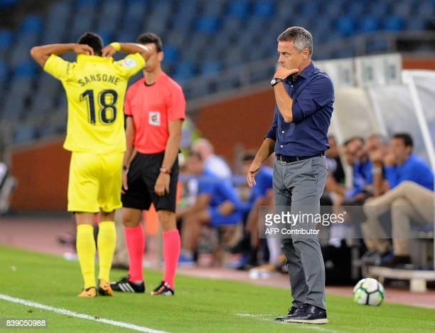 Villarreal's coach Fran Escriba Segura gestures from the sideline during the Spanish league football match Real Sociedad vs Villarreal CF at the...