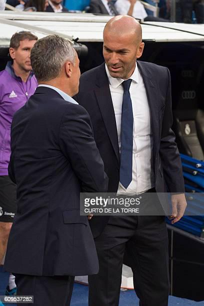 Villarreal's coach Fran Escriba Segura greets Real Madrid's French coach Zinedine Zidane before the Spanish league football match Real Madrid CF vs...