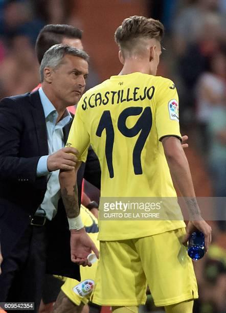Villarreal's coach Fran Escriba Segura talks with Villarreal's midfielder Samuel Castillejo during the Spanish league football match Real Madrid CF...