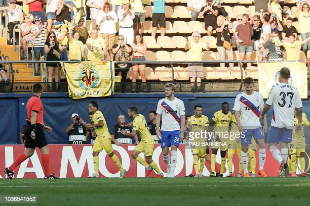 Villarreal's Colombian forward Carlos Bacca celebrates scoring the opening goal during the UEFA Europa League group G football match between...
