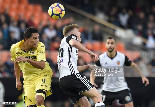 Villarreal's Colombian forward Carlos Bacca vies with Valencia's defender Antonio Latorre 'Lato' during the Spanish league football match Valencia CF...