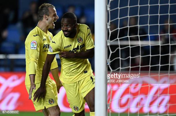 Villarreal's Congolese forward Cedric Bakambu celebrates a goal beside Villarreal's forward Roberto Soldado during the Spanish league football match...