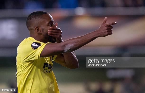 Villarreal's Congolese forward Cedric Bakambu celebrates a goal during the UEFA Europa League Round of 16 first leg football match Villarreal CF vs...