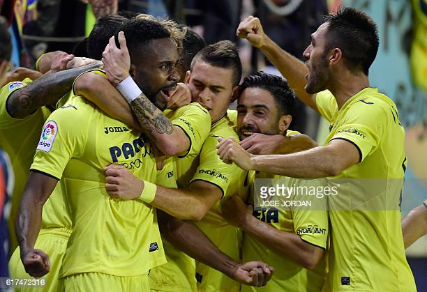 Villarreal's Congolese forward Cedric Bakambu celebrates a goal with teammates during the Spanish league football match between Villarreal CF and UD...