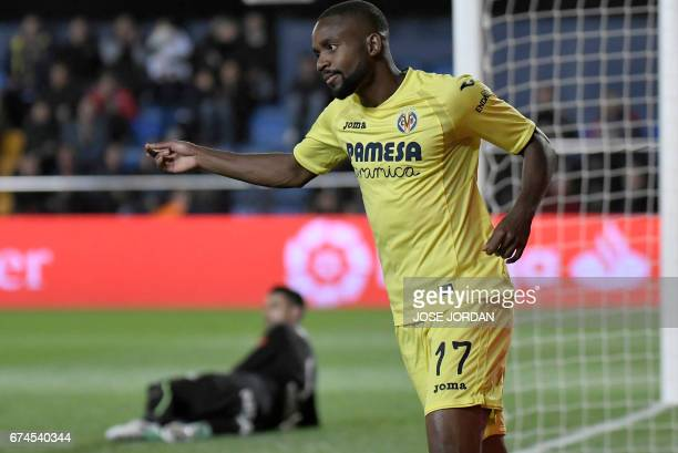 Villarreal's Congolese forward Cedric Bakambu celebrates after scoring a goal during the Spanish league football match Villarreal CF vs Real Sporting...