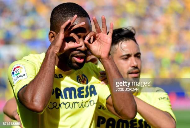 Villarreal's Congolese forward Cedric Bakambu celebrates past Villarreal's defender Jaume Costa after scoring during the Spanish league football...
