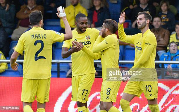 Villarreal's Congolese forward Cedric Bakambu celebrates with teammates after scoring during the Spanish league football match Villarreal CF vs...