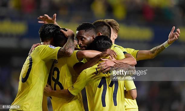 Villarreal's Congolese forward Cedric Bakambu celebrates with teammates after scoring during the Spanish league football match Villarreal CF vs RC...