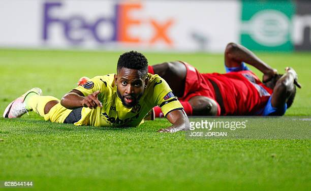 Villarreal's Congolese forward Cedric Bakambu gestures as he lies on hte field during the UEFA Europa League football match Villarreal CF vs FC...
