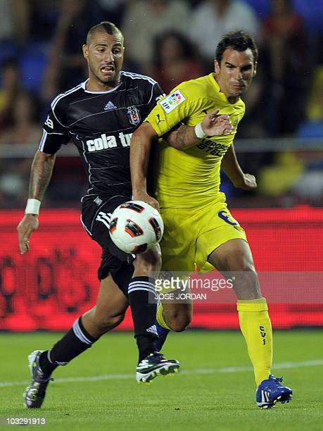 Villarreal´s defender Angel vies for the ball with Besiktas' Ricardo Andrade Quaresma during their Ceramics Trophy football match at the Madrigal...