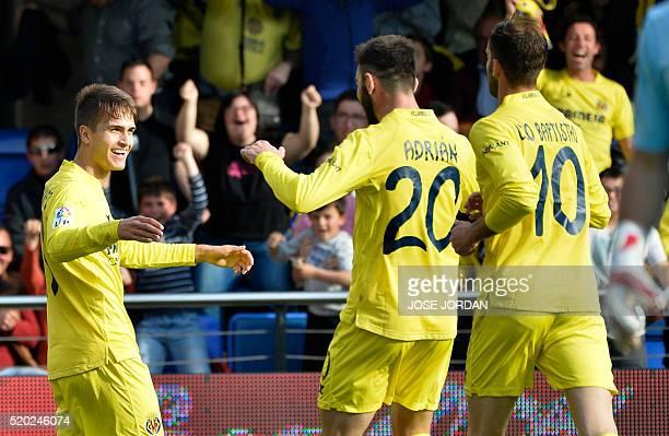 Villarreal's defender Denis Suarez celebrates with teammates after scoring during the Spanish league football match Villarreal CF vs Getafe CF at El...