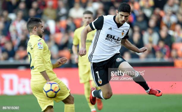 Villarreal's defender Mario vies with Valencia's Portuguese midfielder Manuel Guedes during the Spanish league football match Valencia CF and...