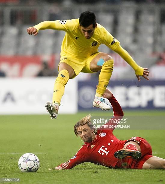 Villarreal's Dutch midfielder Hernan Perez and Bayern Munich's Ukrainian midfielder Anatoliy Tymoshchuk vie for the ball during the Champions League...