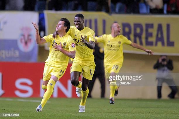 Villarreal's Dutch midfielder Hernan Perez celebrates with Villarreal's Colombian defender Cristian Zapata and Villarreal's midfielder Bruno Soriano...