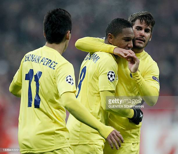 Villarreal's Dutch midfielder Jonathan de Guzman Villarreal's defender Joan Oriol and Villarreal's Dutch midfielder Hernan Perez celebrate the first...