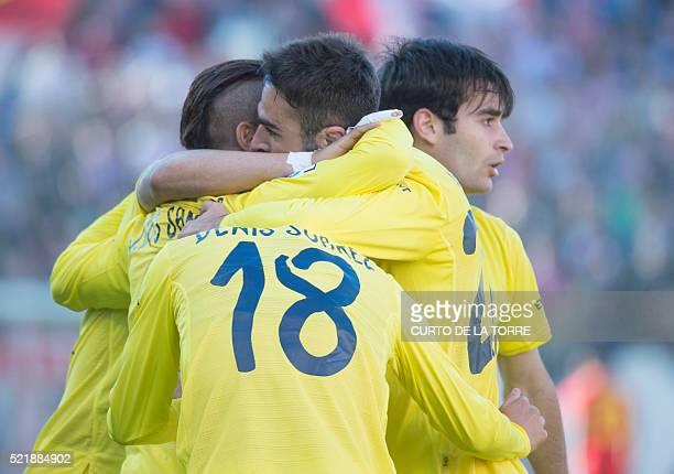 Villarreal's forward Adrian celebrates after scoting with teammates during the Spanish league football match CF Rayo Vallecano vs Villarreal CF at...