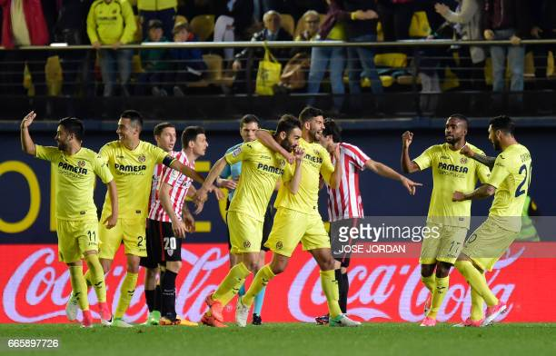Villarreal's forward Adrian Lopez celebrates a goal with teammates during the Spanish league football match Villarreal CF vs Athletic Club Bilbao at...