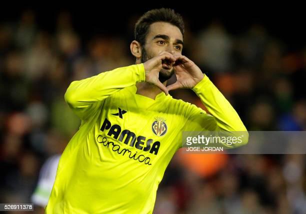 Villarreal's forward Adrian Lopez celebrates his second goal during the Spanish league football match Valencia CF vs Villarreal CF at the Mestalla...