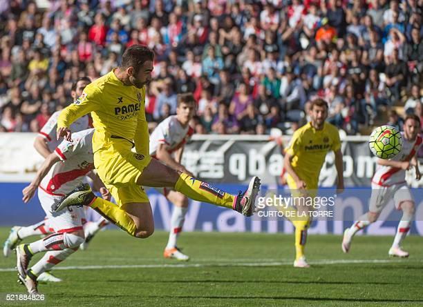 Villarreal's forward Adrian scores during the Spanish league football match CF Rayo Vallecano vs Villarreal CF at the Vallecas stadium in Madrid on...