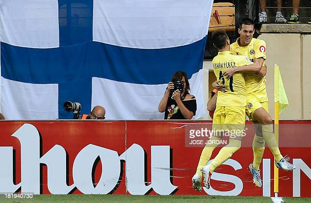 Villarreal's French forward Jeremy Perbet celebrates with Villarreal's Paraguayan midfielder Hernan Perez after scoring during the Spanish league...