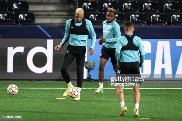 Villarreal's French midfielder Etienne Capoue and Nigerian midfielder Samuel Chukwueze attend a training session on the eve of the UEFA Champions...