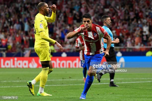 Villarreal's French midfielder Etienne Capoue reacts to Atletico Madrid's Uruguayan forward Luis Suarez's goal during the Spanish League football...
