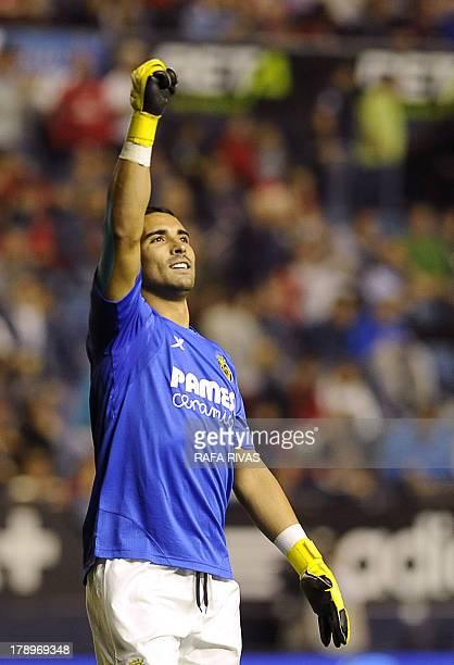 Villarreal's goalkeeper Sergio Asenjo celebrates his team's third goal during the Spanish league football match Club Atletico Osasuna vs Villarreal...